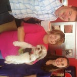 Felicia Compton, of St. Louisville, won a summer-long Donatos contest and decided to donate her winnings to a Pataskala dog-rescue group, Ohio Fuzzy Pawz Shih Tzu Rescue. Pictured from left to right, Newark Donatos franchise partner Brian Crumley poses with Dawn Allen, director of Ohio Fuzzy Pawz, and Herbie, one of the dogs the group rescued, along with Compton.