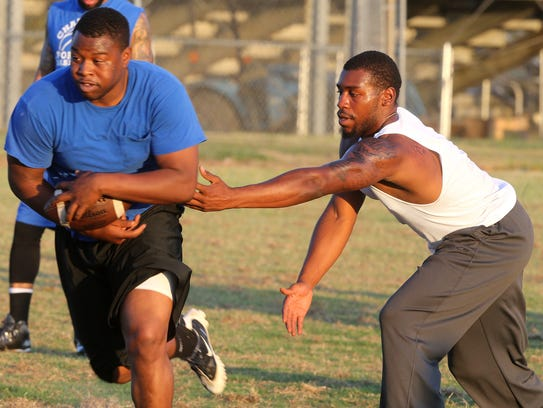 Oakland's B.J. Nelson gets the handoff from Travon