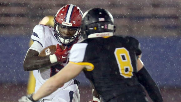 Stepinac's Trill Williams rushes against St. Anthony