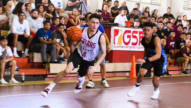 In this Jan. 13, 2018, file photo, Saint Paul plays Father Duenas in the GSPN Preseason Boys Basketball Tournament. The two teams square off Feb. 20.