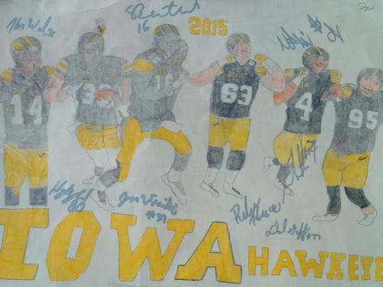 A photographed copy of the poster that Jay Knabe, 14, had signed by C.J. Beathard and several other Hawkeyes at the April 25 spring game. Knabe included his phone number and a letter with the poster and Beathard called him ... the two have remained friends in faith since.