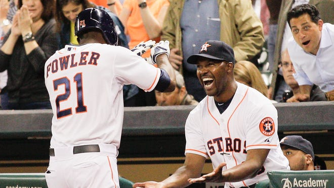 Dexter Fowler and Bo Porter celebrate a home run.