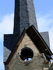 The heavily damaged  tower at First Baptist Church in Portland on June 23, 2015 after the previous day's tornado.
