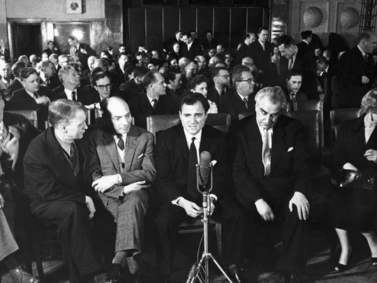 """American film producer Mike Todd, center, is shown immediately before a preview of his film """"Around the world in eighty days"""" in Moscow, Russia, on Feb. 1, 1958."""