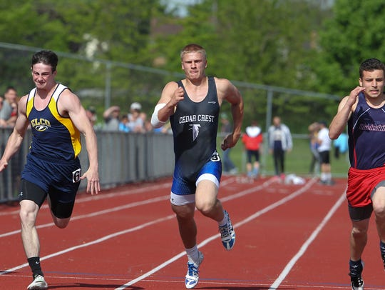 Ethan Anspach, of Elco, left, finished third and Evan
