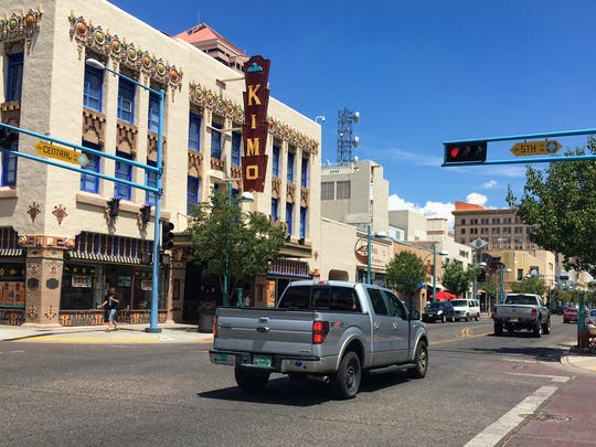 FILE--This Aug. 1, 2016, file photo shows the Kimo Theater on Albuquerque's historic Route 66 in Albuquerque, N.M.  Route 66, the historic American roadway that linked Chicago to the West Coast, soon may be dropped from a National Park Service preservation program. A federal law authorizing the Route 66 Corridor Preservation Program is set to expire in two years and with it would go millions of dollars in grants for reviving old tourist spots in struggling towns. . (AP Photo/Russell Contreras, file)