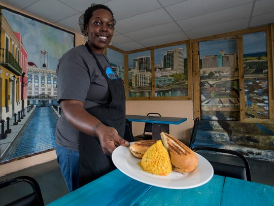 Melody Rivera serves up lunch at Willies Place, a Puerto