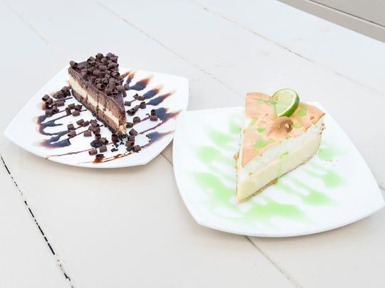 Triple chocolate cheesecake and keylime pie at Fish House in Pensacola on Wednesday, July 25, 2018.