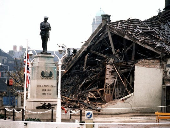 The Cenotaph at Enniskillen with the devastated community