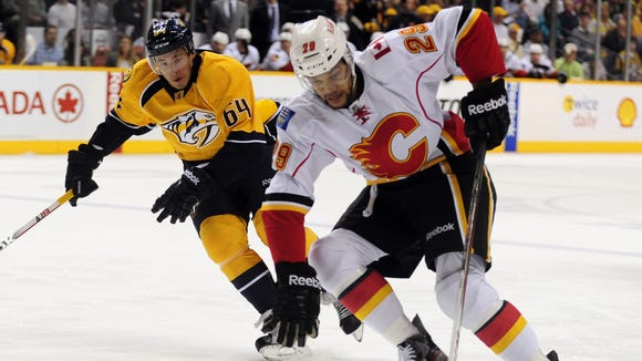 Winger Akim Aliu has played five season of pro hockey but skated in just seven NHL games, all with the Calgary Flames.