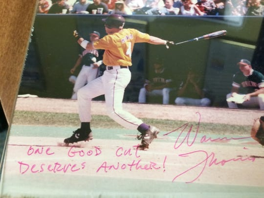 A framed photo of Warren Morris' 1996 home run.