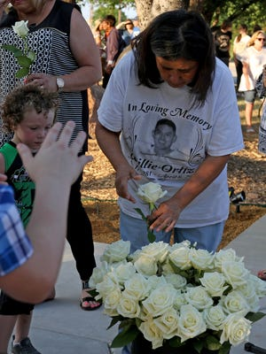 White roses were given out to those who lost someone close to them Saturday, June 23, 2018, at the Angel of Hope dedication ceremony at the MPEC in memory of Lauren Landavazo and other children who have lost their lives.