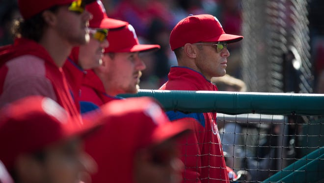 Phillies manager Gabe Kapler watches from the dugout during the home opener against the Miami Marlins on Thursday at Citizens Bank Park.