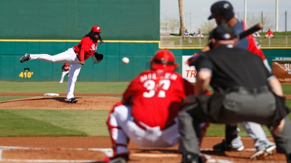Reds pitcher Johnny Cueto throws against the Cleveland Indians at Goodyear Ballpark on Feb. 26.