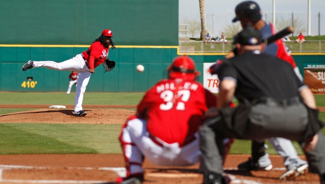 Johnny Cueto throws against the Cleveland Indians Michael Brantley on February 26.
