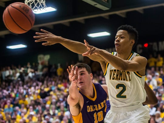 UVM's Trae Bell-Haynes heaves a pass to the corner during the 2017 America East men's basketball championship game vs. Albany at Patrick Gym in March.