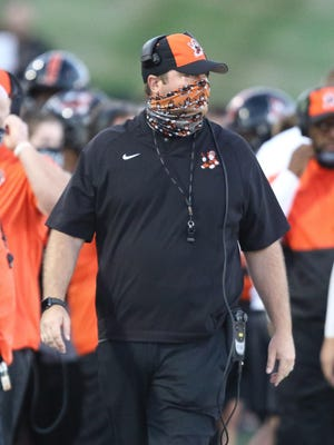 Massillon coach Nate Moore walks the sidelines during the Tigers' Week 2 win over Columbus Bishop Sycamore on Friday September 4th 2020.