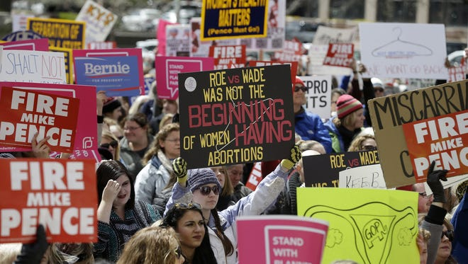 Thousands rally for women's rights on the south lawn of the Indiana State House on April 9, 2016. The rally was in response to a controversial new Indiana abortion bill. A reader was once in favor of abortion rights but says that as he has matured he is now opposed to abortion.