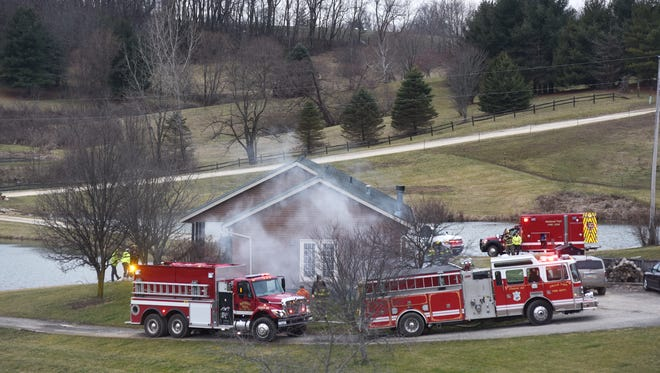 Fire trucks surround a home on Murray Drive in Zanesville on Wednesday evening.