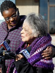 Rep. Gwen Moore (left) (D-Wis.) and former Secretary of State Vel Phillips hold a news conference outside the vehicle registration station on N. Teutonia Ave. after a Supreme Court ruling blocking implementation of Wisconsin's voter ID law in 2014.