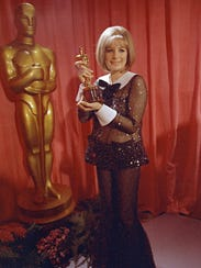 Barbra Streisand poses with her Oscar for 'Funny Girl.'