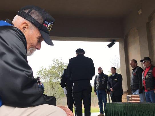 Korean War veteran Robert Weed sits in silence during