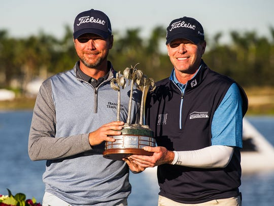 Sean O'Hair and Steve Stricker,  left to right, hold up their trophy after winning the QBE Shootout at Tiburón Golf Club in Naples on Sunday.