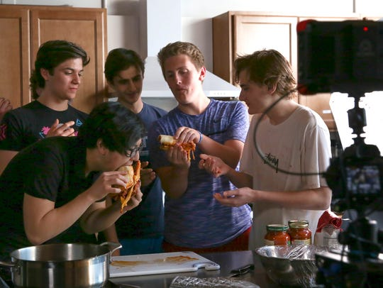 Students from The Harley School take a bite of cheesy