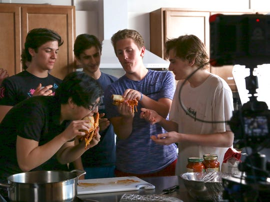 Students from The Harley School take a bite of cheesy blasters prepared by Andrew Rea.
