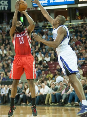 Houston Rockets shooting guard James Harden (13) takes a shot over Sacramento Kings small forward Travis Outlaw during the second quarter at Sleep Train Arena.