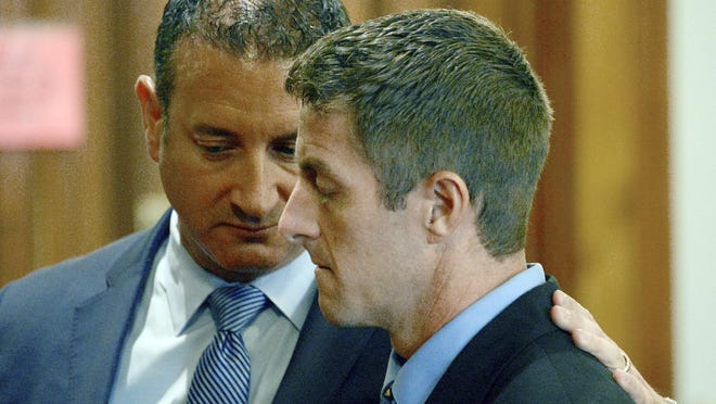 Michigan State University basketball strength coach Todd Moyer, foreground, consoled by his attorney Neil Rockind, closes his eyes as he was found guilty by a jury of two counts of reckless driving causing death last month.