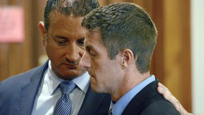 In this July 20, 2018, file photo, former Michigan State University basketball strength coach Todd Moyer, foreground, is consoled by his attorney Neil Rockind, in court as he was found guilty by a jury of two counts of reckless driving causing death in Monroe, Mich. Moyer was sentenced Thursday, Aug. 30, 2018, to 86 months to 15 years for a crash that killed two people last year.