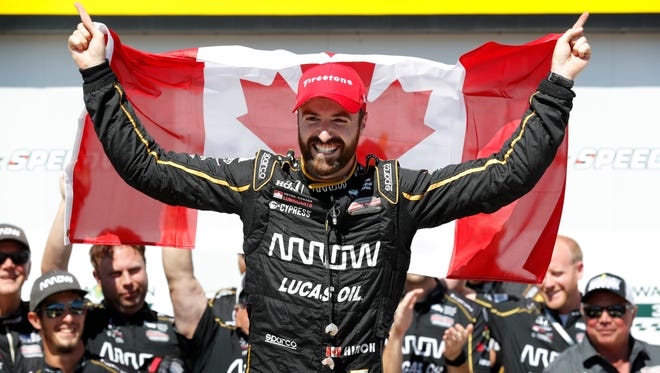 James Hinchcliffe celebrates after winning an IndyCar Series auto race Sunday, July 8, 2018, at Iowa Speedway in Newton, Iowa.