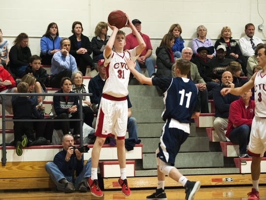 CVU's Walker Storey (31) shoots a three point shot
