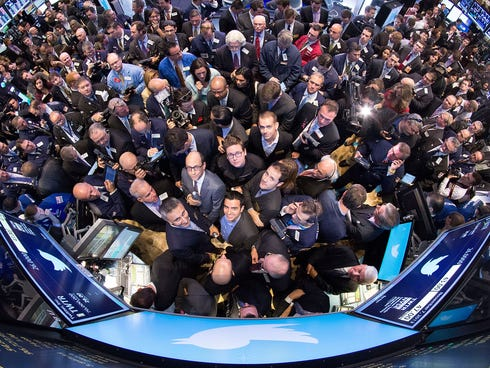 The New York Stock Exchange trading floor is crowded with traders and journalists on the morning of Twitter's public stock debut on Nov. 7.