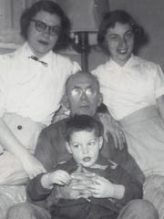 This portrait of the Halley family of Elmira was taken in the mid 1950s. Seated is father William Halley holding son, Dennis. Top left is mother, Mable Halley, with daughter, Pat Halley.