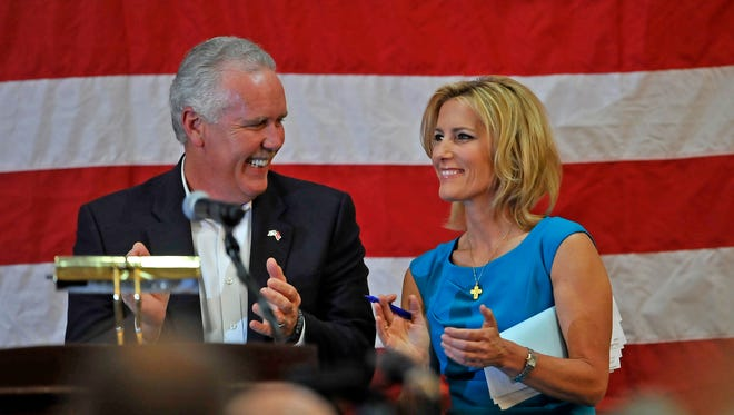 Laura Ingraham, right, talks with Joe Carr after speaking during a rally for Carr on Tuesday at Millennium Maxwell House Hotel in Nashville.