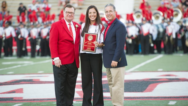 Former UL pitcher Melissa Coronado is pictured with UL president Joseph Savoie, left, and athletic director Scott Farmer, right.