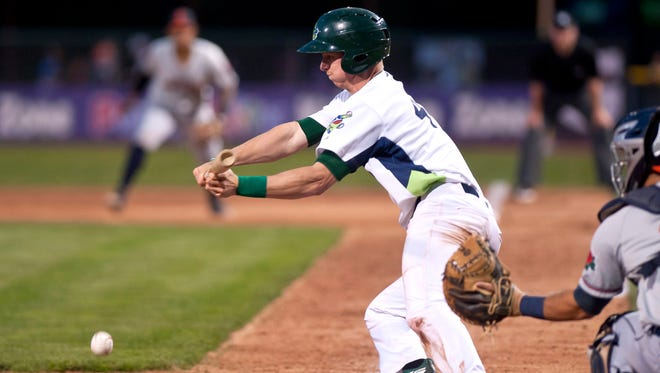 Vermont Lake Monsters shortstop Kevin Merrell attempts a bunt against the Connecticut Tigers during Wednesday night's baseball game at Centennial Field.