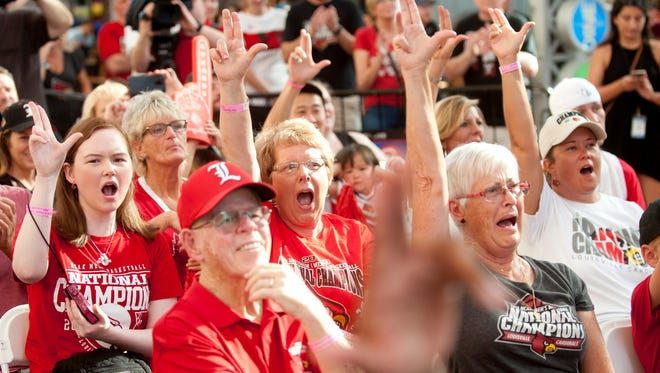 """Fans form the letter """"L"""" with their hands at a gathering of the 2013 University of Louisville men's basketball team at Fourth Street Live. The team members were back tin Louisville to celebrate the 5-year reunion of the team's national championship victory over Michigan.June 29, 2018"""
