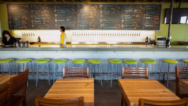 The beer list and dining area at Angels Trumpet Ale House in downtown Phoenix.