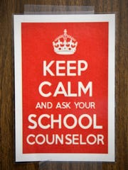 A sign asks students to keep calm and ask their school