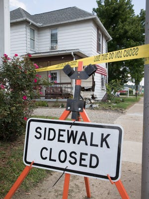 The sidewalk in front of an East Main Street house has been closed due to a Friday afternoon accident where a truck crashed into the front of the house.