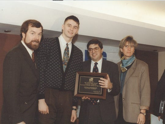 Arturas Karnisovas (2nd from left) receives the 1993 Big East scholar-athlete award with coach P.J. Carlesimo, commissioner Mike Tranghese and academic advisor Robin Cunningham.