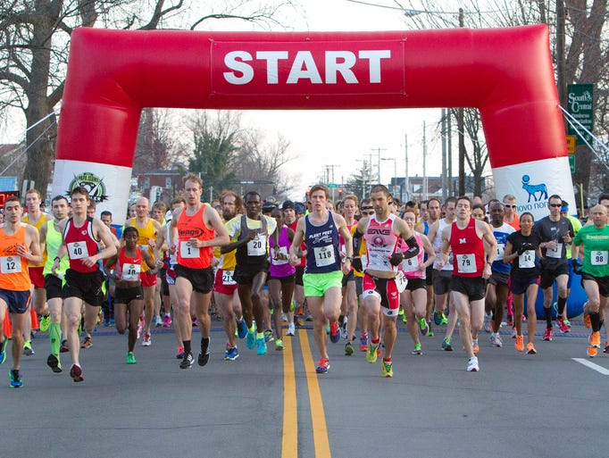 Runners leave the starting line of the Papa John's 10 Miler on 3rd. March 22, 2014.
