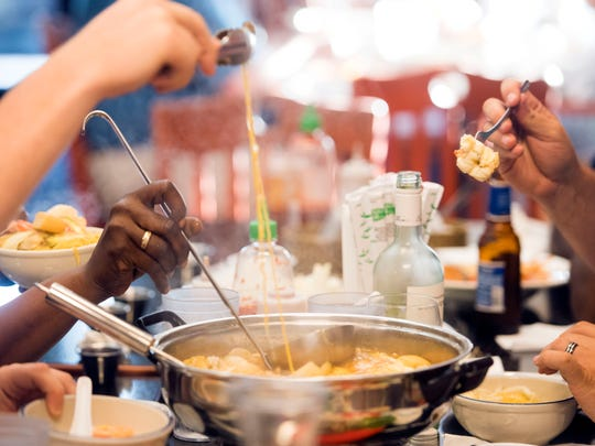 Diners enjoy a hot pot dinner at Sticky Rice Cafe on Tuesday, June 5, 2018.