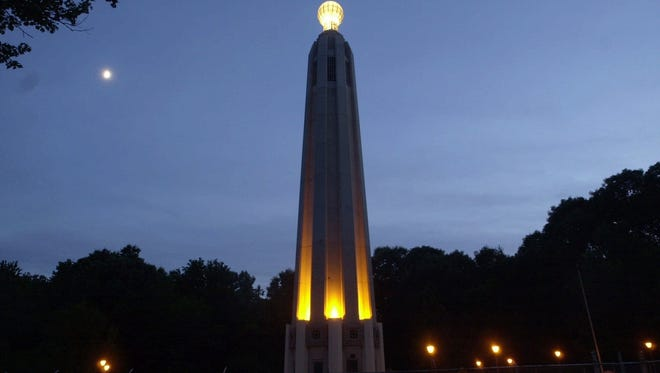 The Edison Memorial Tower is pictured while lit in 2001. After years of disrepair, the tower has undergone nearly a $4 million restoration and will be rededicated and relighted on Oct. 24 during a ceremony at the Thomas Edison Center at Menlo Park.