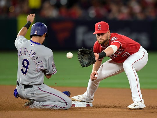 Texas Rangers' Isiah Kiner-Falefa, left, is forced out at second by Los Angeles Angels short stop Zack Cozart on a ball hit by Shin-Soo Choo during the fifth inning of a baseball game Friday, May 24, 2019, in Anaheim, Calif. (AP Photo/Mark J. Terrill)