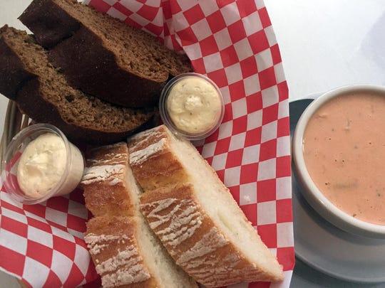 Delicious fresh bread and artichoke bisque