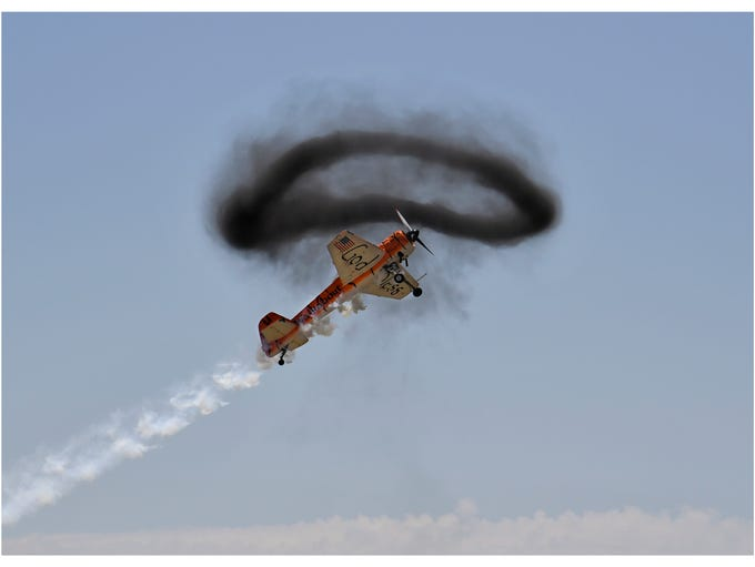 One of the Twin Tiger Aerobatic Team pilots flies through
